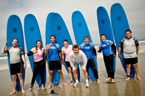 group of people with surf boards