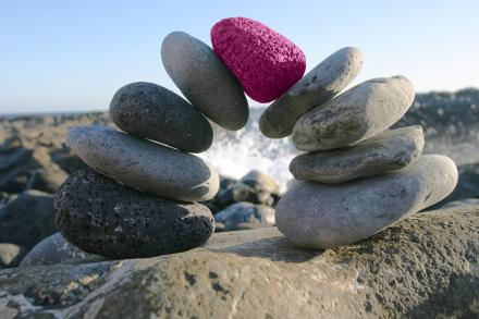 Stack of Rocks with One Pink Rock