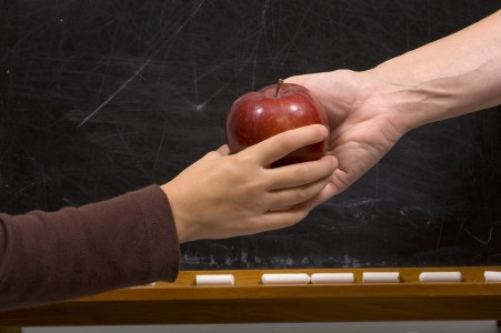 Person Handing Someone An Apple