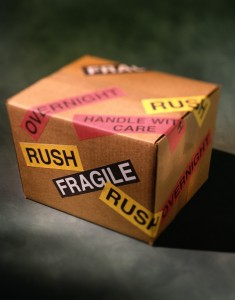 "Package with ""fragile"" and ""rush"" stickers"