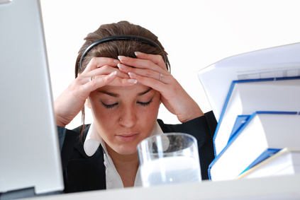 Girl Sitting at Desk Looking Stressed